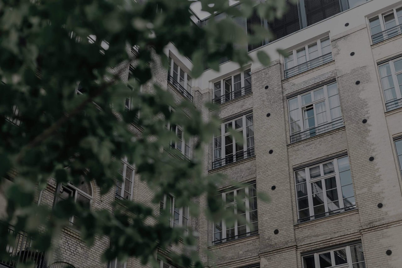Picture of buildings with tree in front